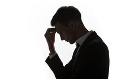 Stressed guy in suit with hand on his head
