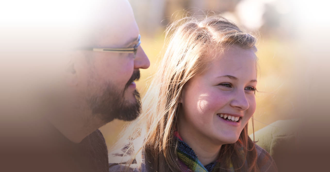 fall time - profile of father with smiling daughter