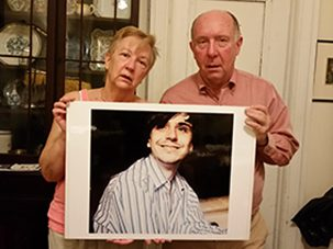 Bill_Williams_Margo_Head_with_photo_of_son_Will_303x227