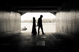 shutterstock - black and white photo of silhouette of couple under tunnel bridge