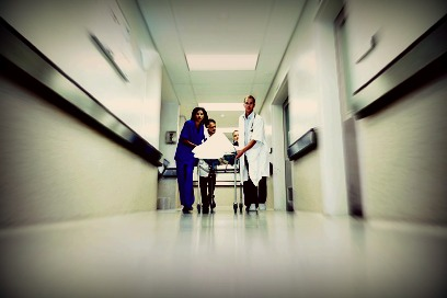 Emergency team rushes a patient down the hospital hallway on a gurney