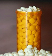 Overflowing-pill-bottle-11-13-13-210x253