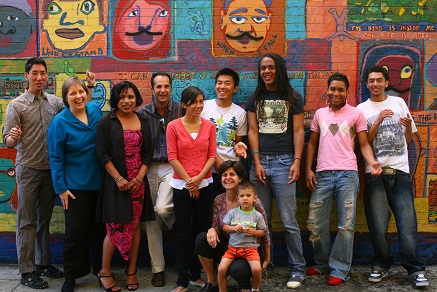 FAP Mural Pix- Families Matter- diverse group of people standing in front of colorful mural