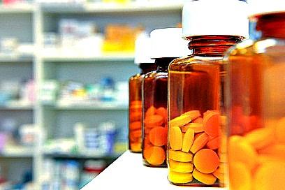 Row of pill bottles in pharmacy