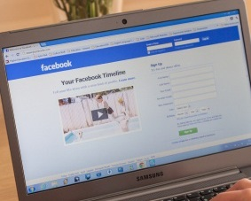 laptop screen with Facebook page open