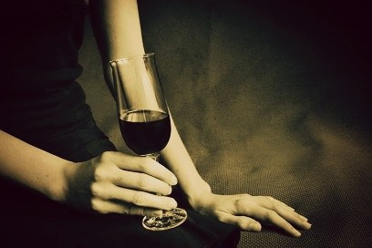 Female hand holding a wineglass