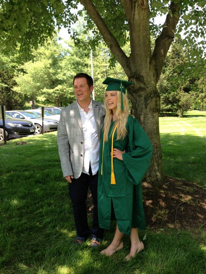 girl in graduation outfit and dad