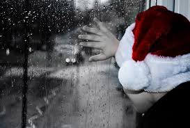 guy with santa hat looking out of a window