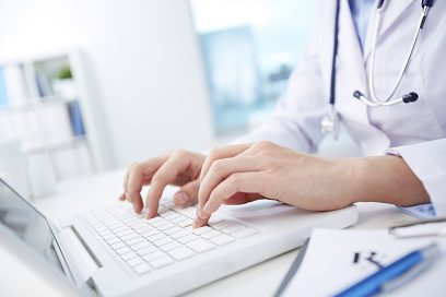 doctor typing on laptop computer