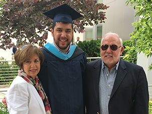 Tim Rabolt at graduation with parents
