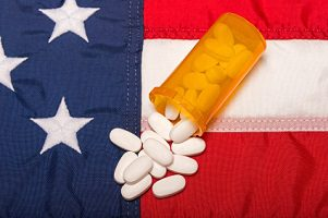 pills spilling on American flag