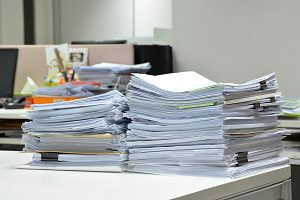 stack of papers on office desk