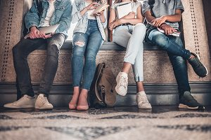sitting group of teens