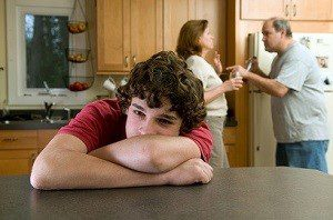 parents fighting with sad teen