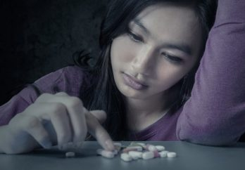 teen girl with pills